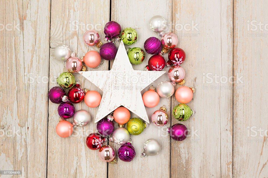 white star between christmas balls stock photo