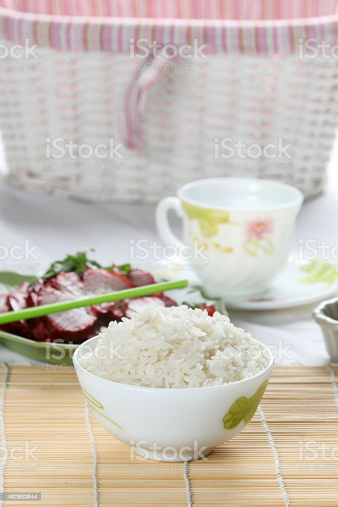 White Steamed rice in white round bowl stock photo