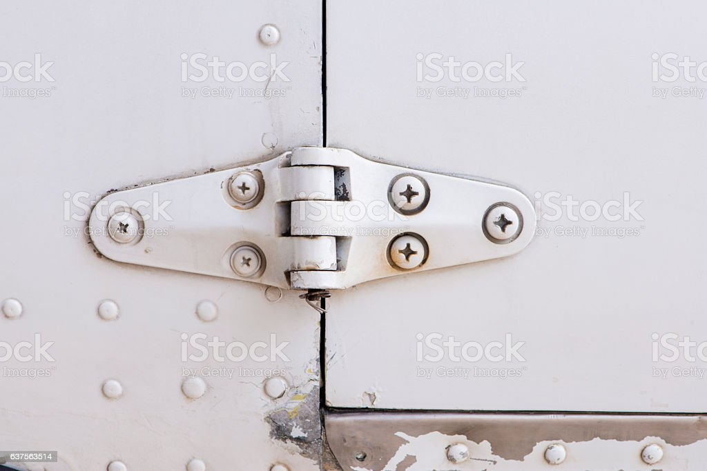 White steel wall with bolts, metal parts connection. stock photo