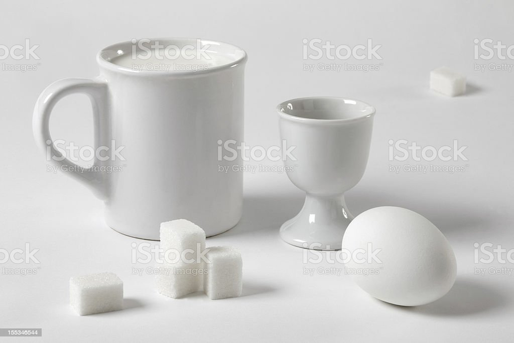White still life with a mug and an egg royalty-free stock photo