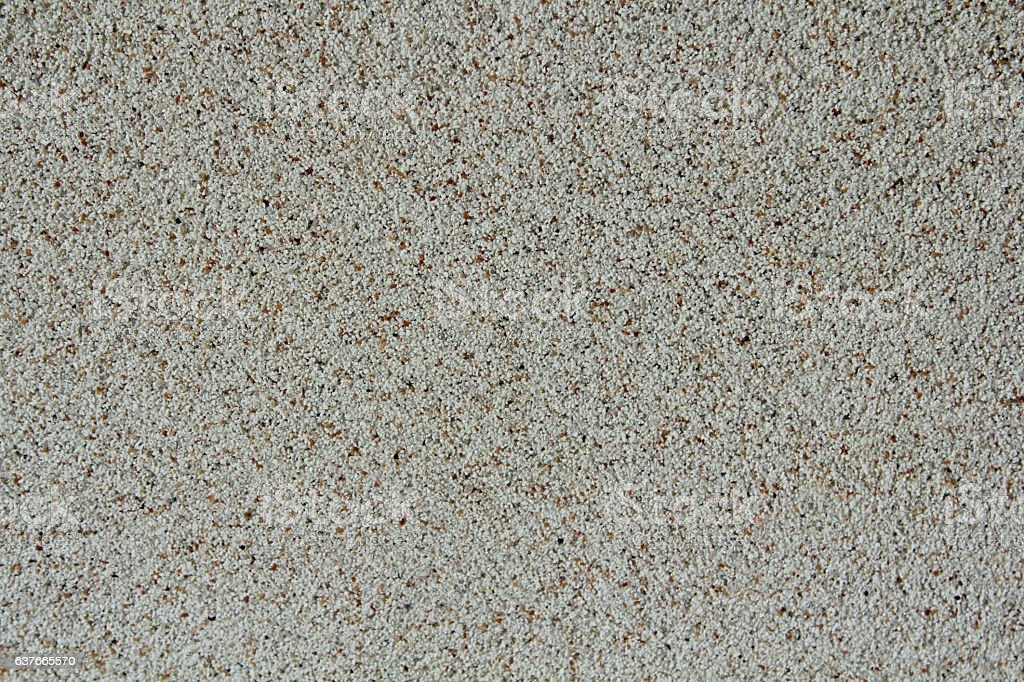 White stone chippings wall. Texture and background stock photo
