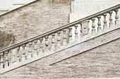 White stone staircase with columns under the railing.
