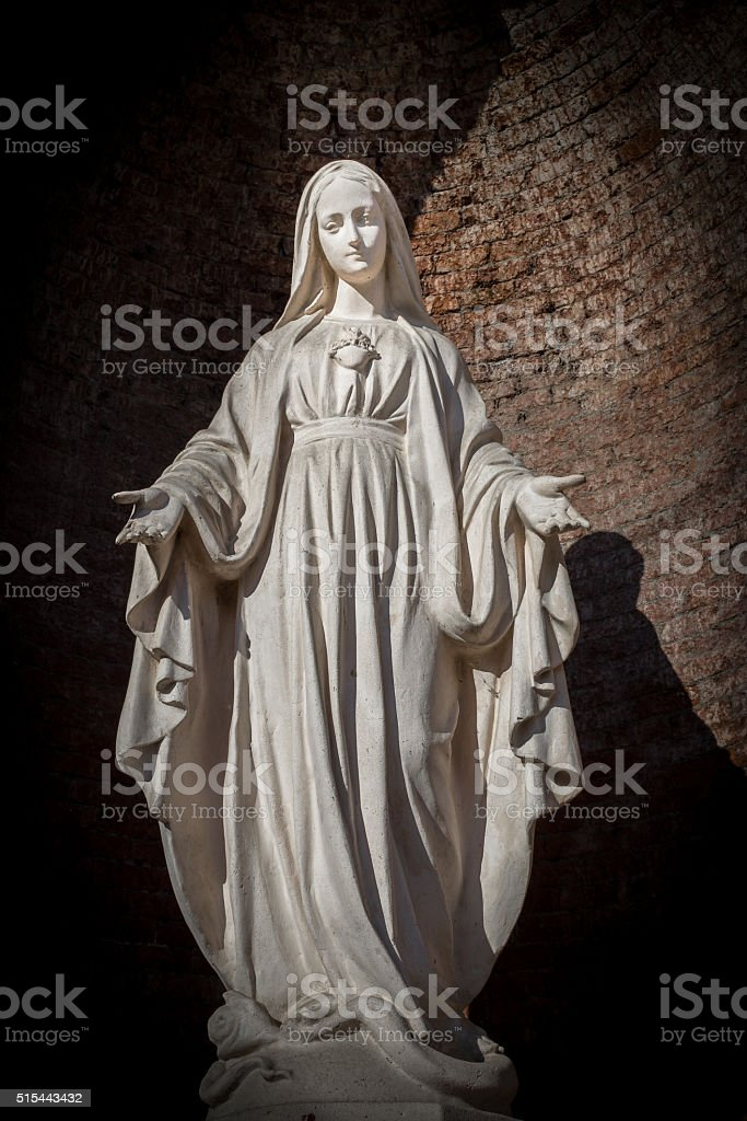 White stone statue of saint Mary stock photo