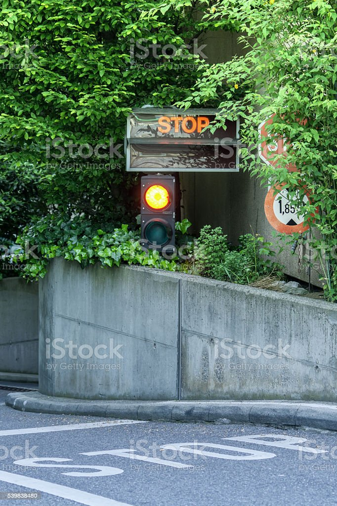 White Stop letter on road and traffic light stock photo
