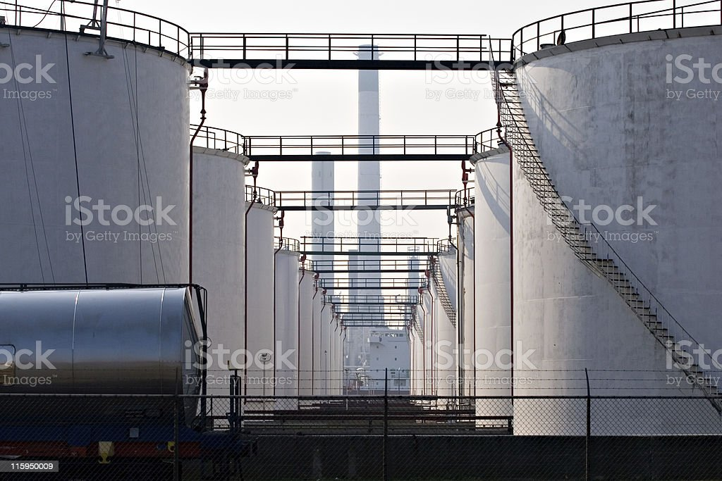 White storage tanks in a row stock photo