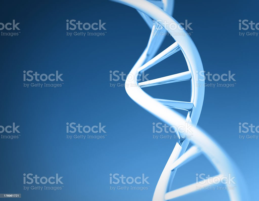 White strain of DNA against blue background stock photo