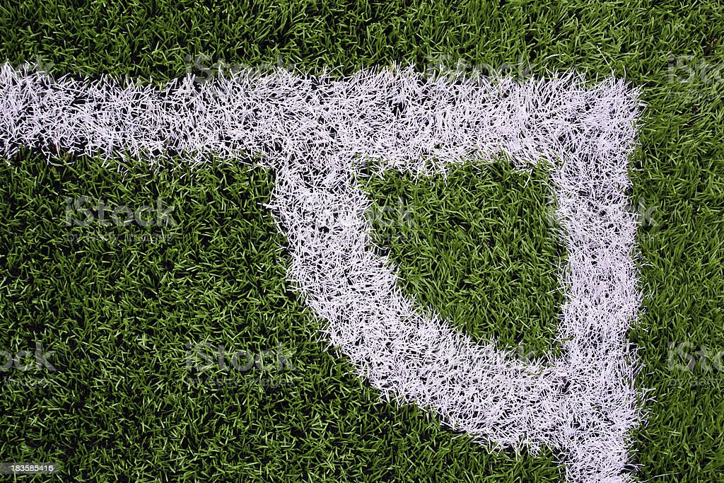 White stripe on the green soccer field royalty-free stock photo