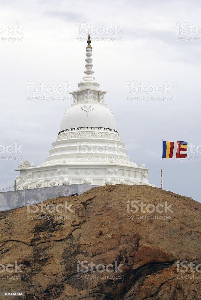 White stupa and flag royalty-free stock photo