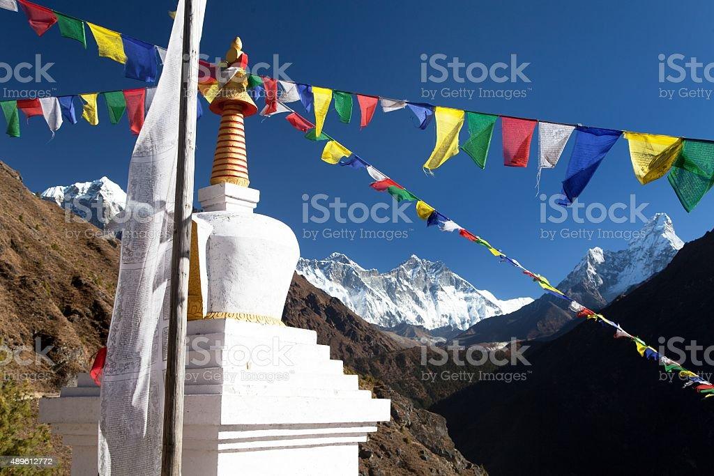 White stupa and prayer flags near Namche Bazar stock photo