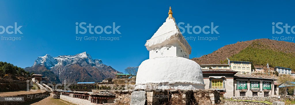 White stupa Buddhist prayer wheels temple shrine panorama Himalayas Nepal stock photo