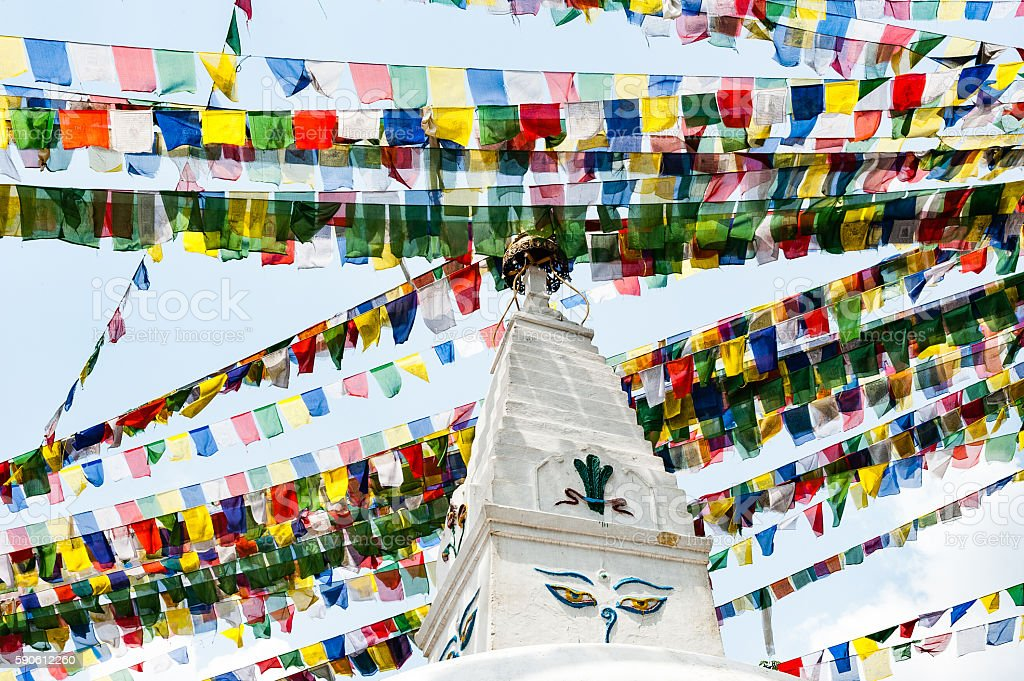 White stupa in Swayambhunath with buddha eyes and prayer flags stock photo