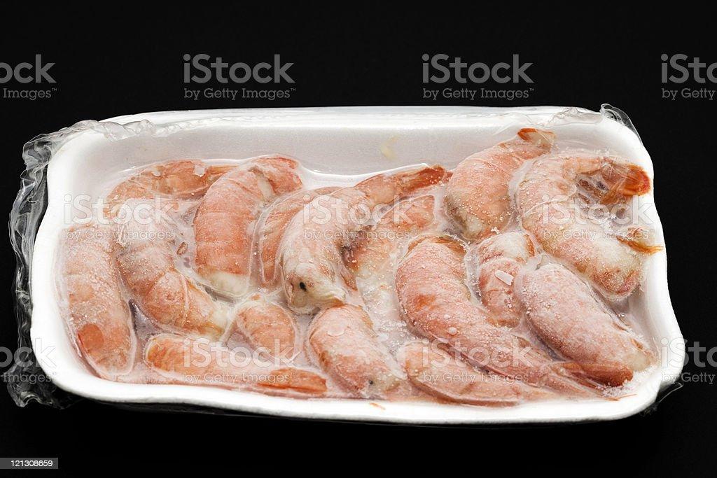 A white Styrofoam tray full of frozen shrimp  stock photo
