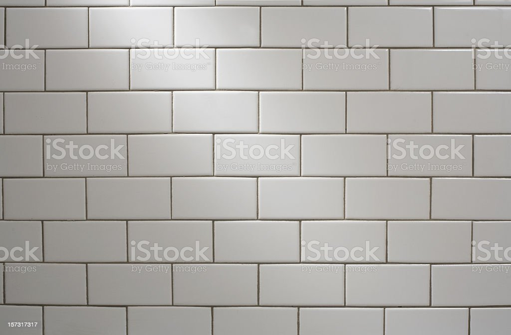 white subway tile with spotlight stock photo