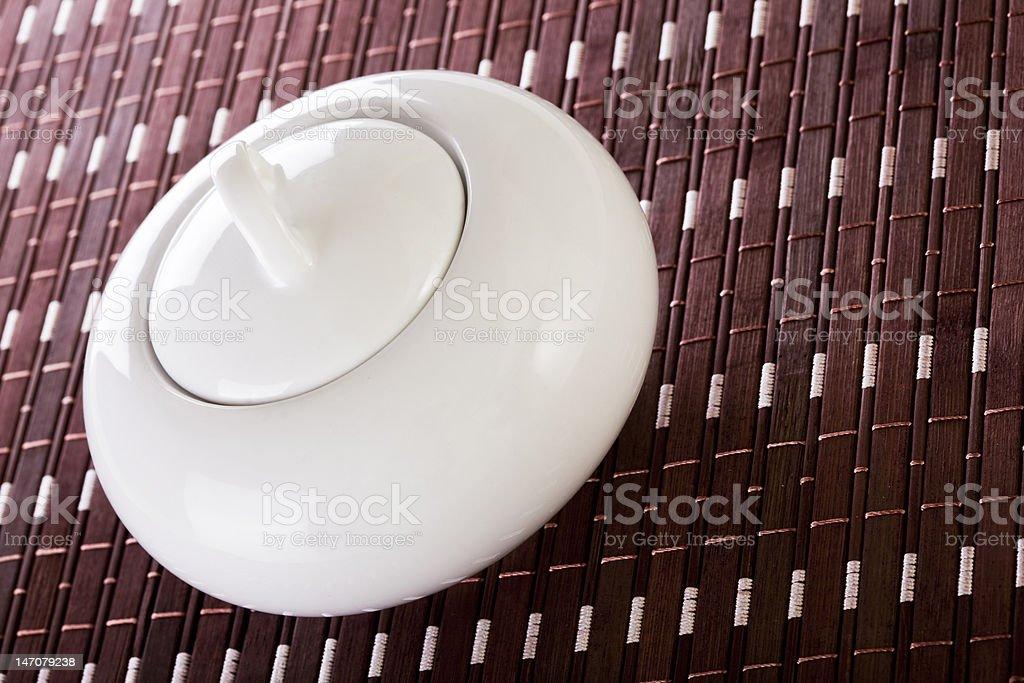 White Sugar Bowl on Placemat royalty-free stock photo