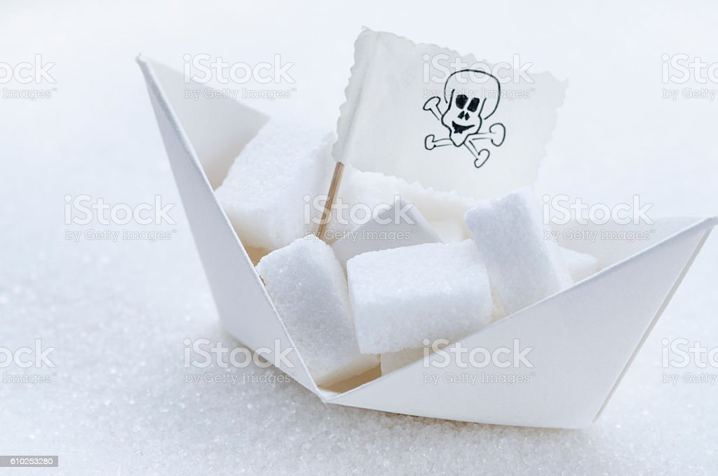 White sugar cubes in a boat stock photo