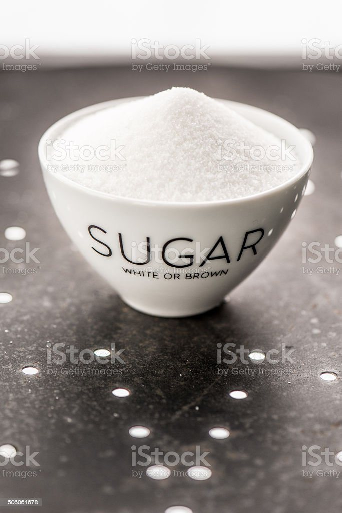 white sugar in a cup stock photo