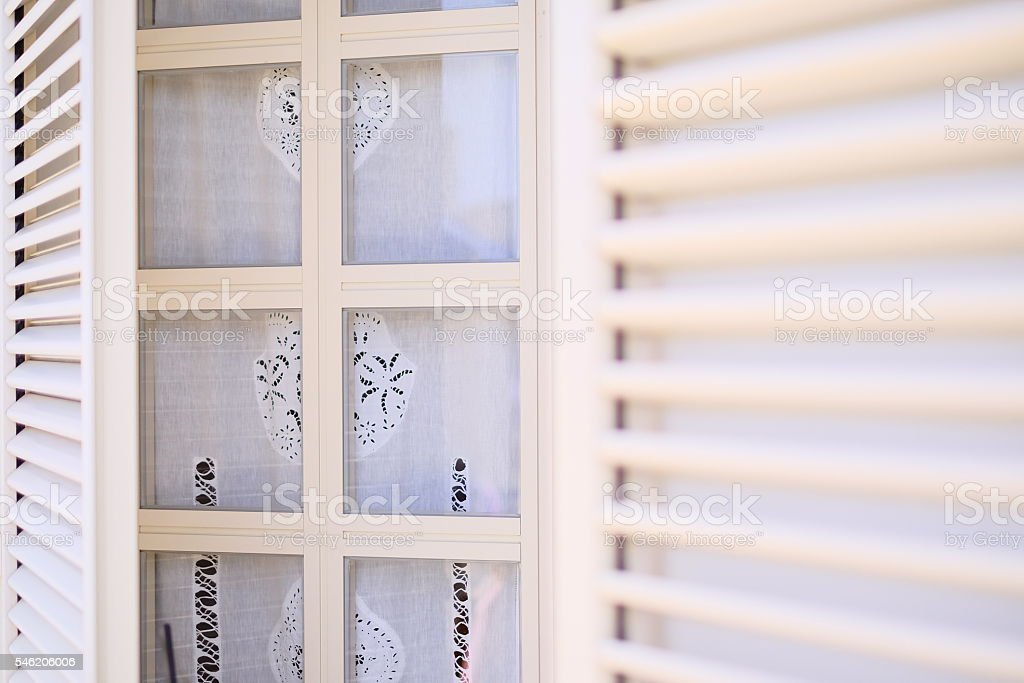 White summery jalousie, ajar stock photo