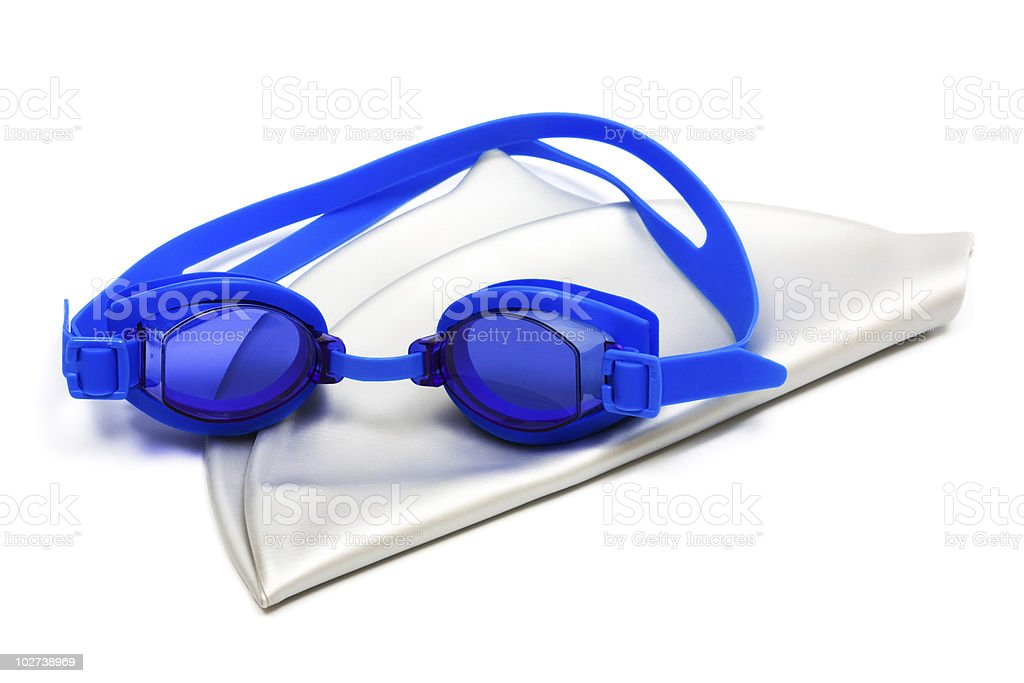 A white swimming cap and blue goggles isolated on white stock photo