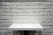 white table and brick wall, simple ascetic interior