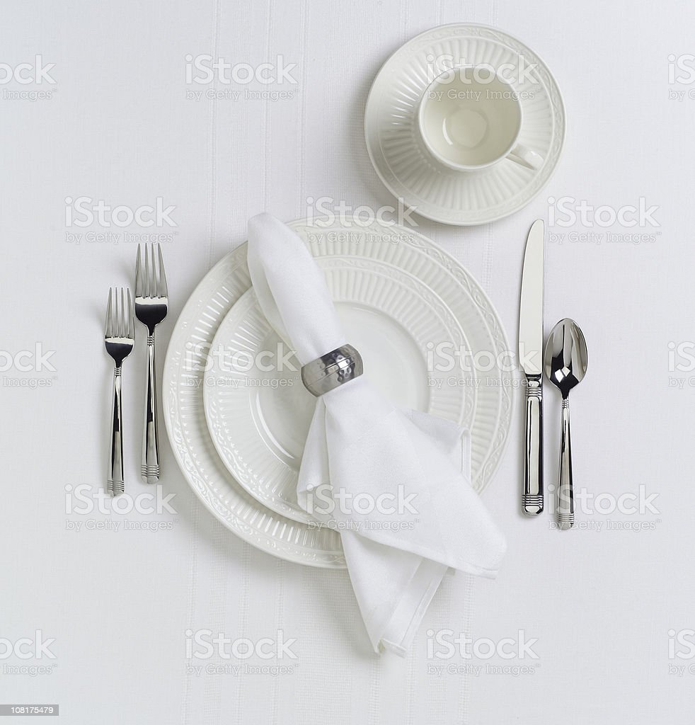 White Table Place Setting with Dishes stock photo