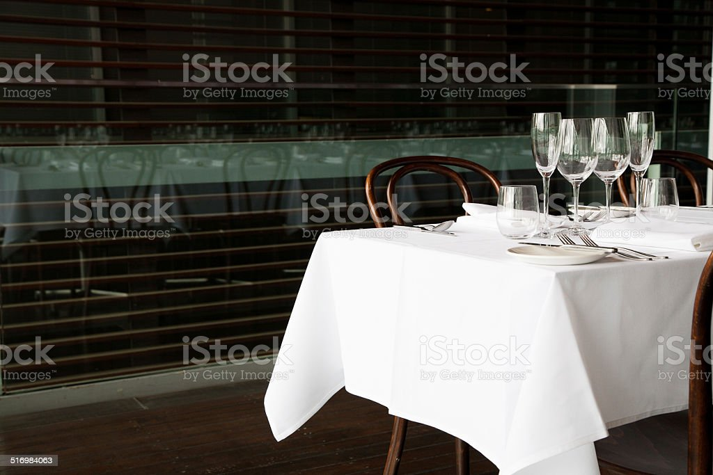 White table setting with reflection stock photo