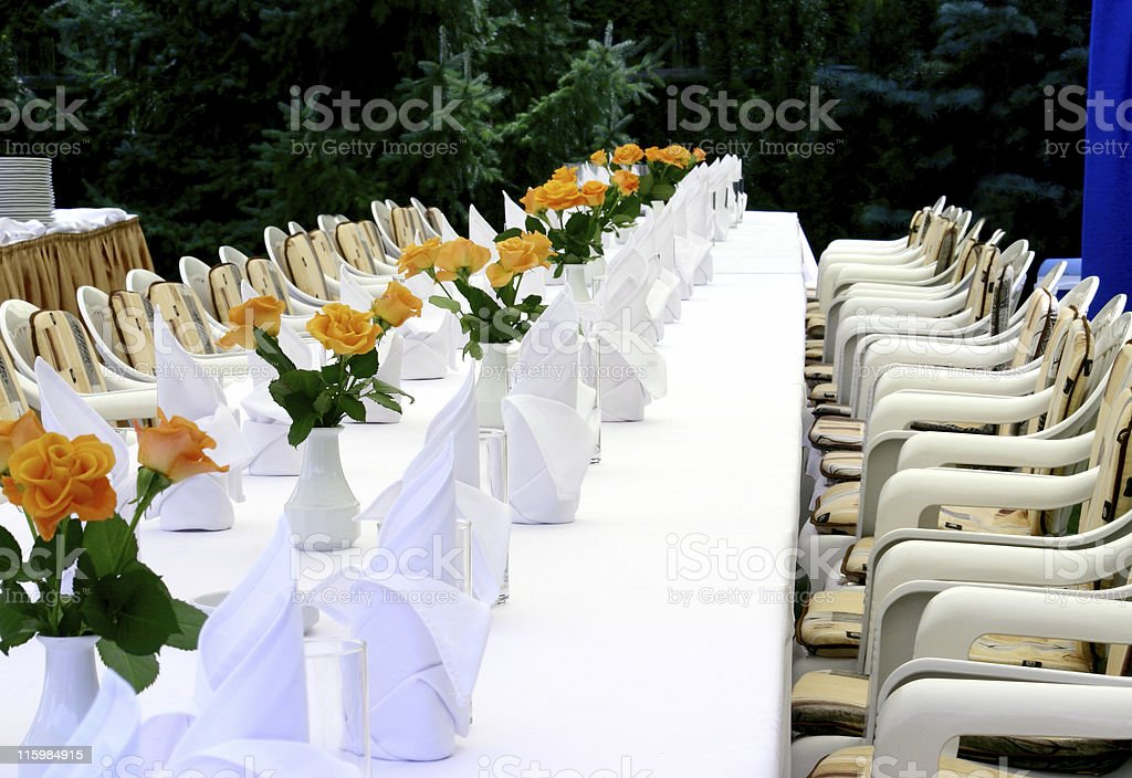 White table with roses royalty-free stock photo