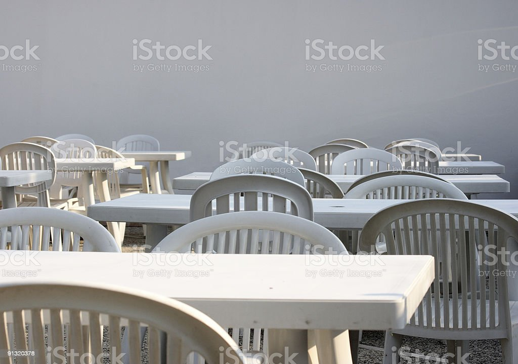 White tables and chairs royalty-free stock photo