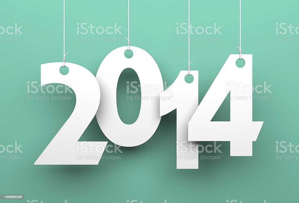 White tags with 2014 on green background stock photo
