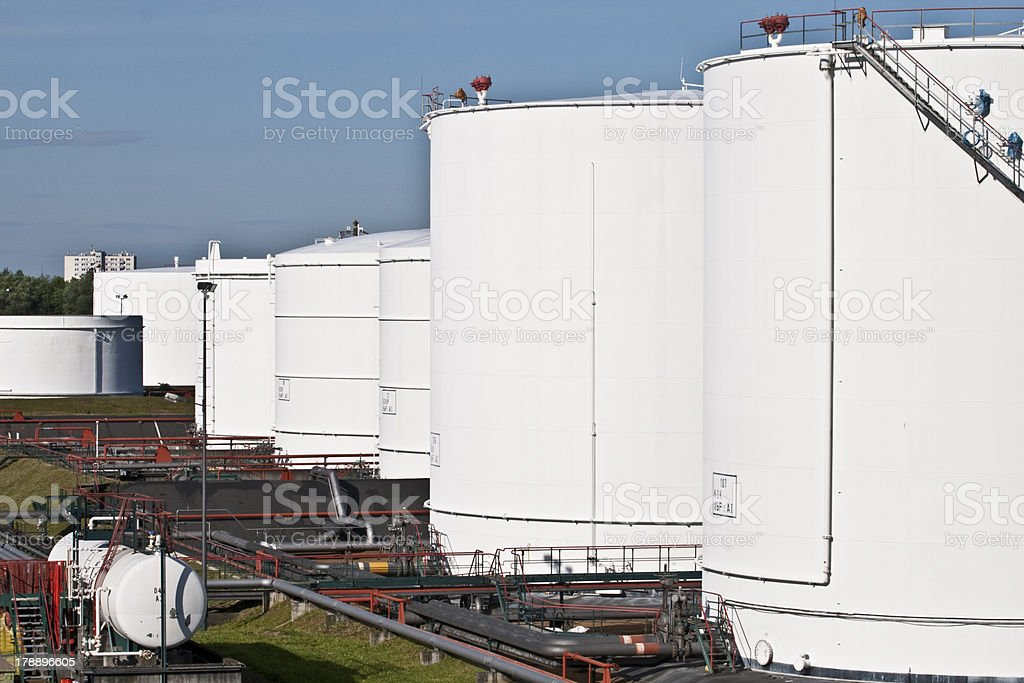 white tanks in tank farm with blue sky royalty-free stock photo
