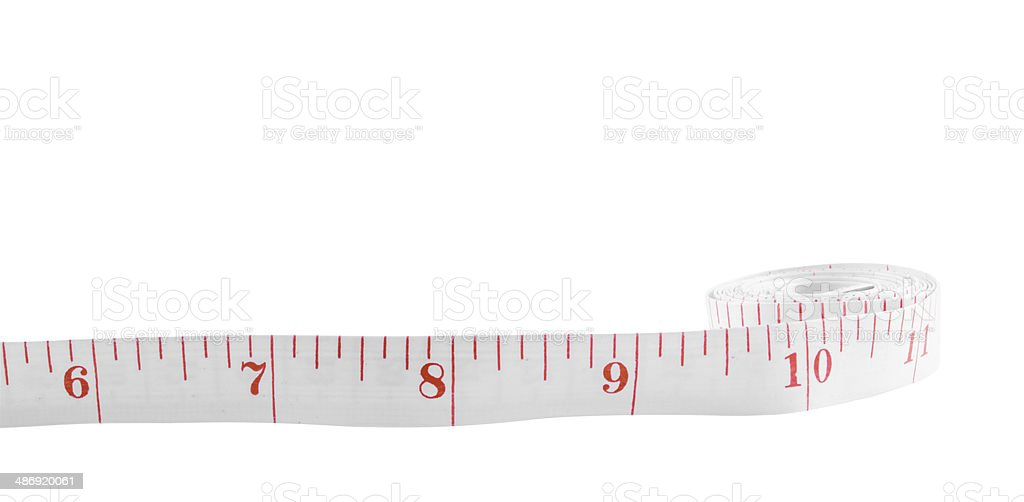 White tape measure on rolled up on white background stock photo