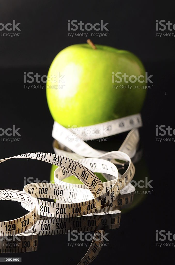 white tapeline and green apple royalty-free stock photo