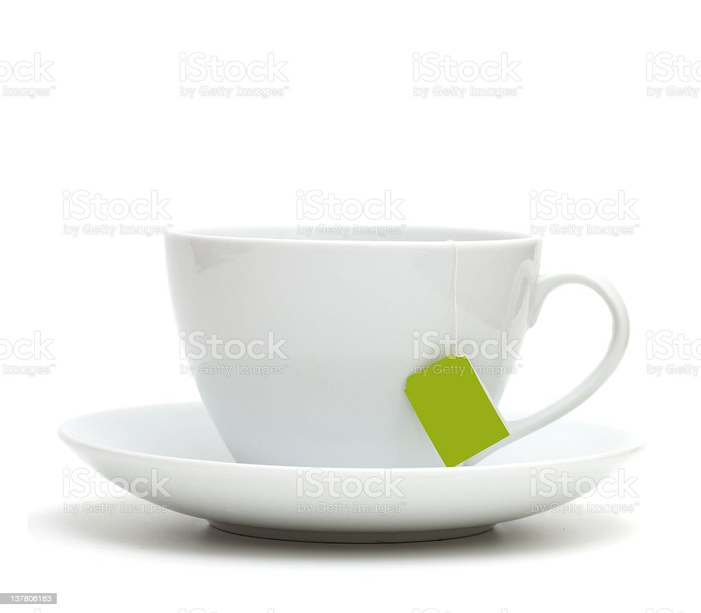 white tea cup on plate with empty label stock photo