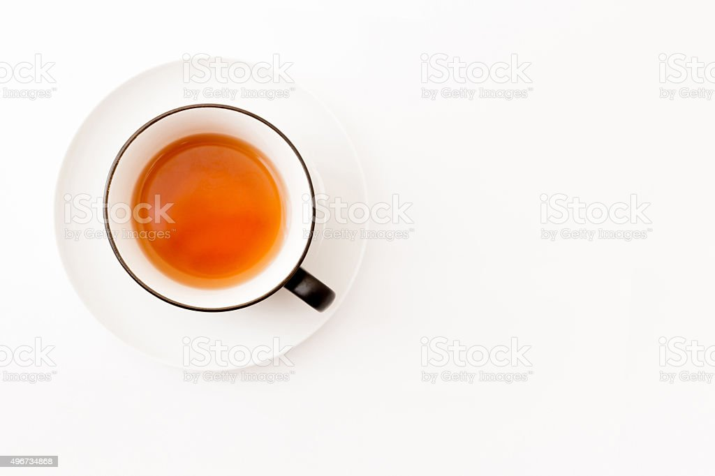 White tea cup over white background, top view stock photo