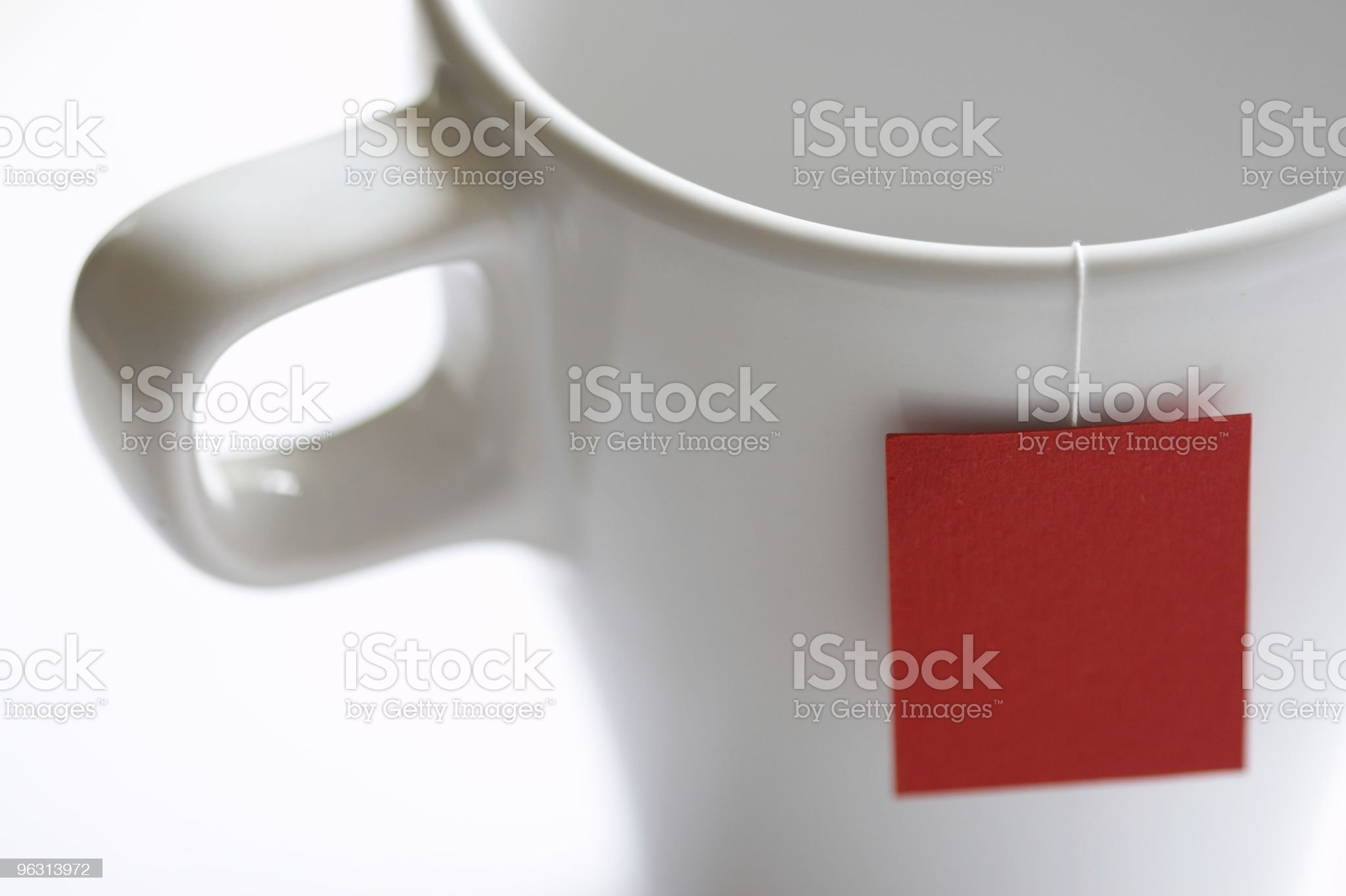 White tea cup with red teabag lable. royalty-free stock photo