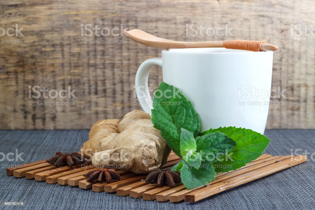 White tea mug with lemon, mint and ginger stock photo