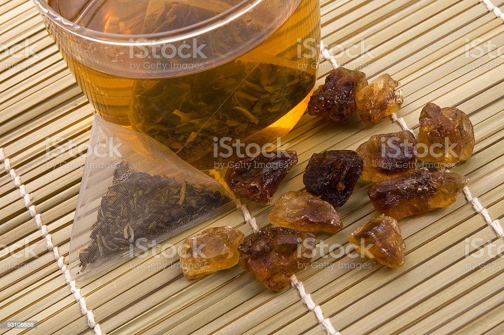 white tea, nylon tea-bag and golden sugar royalty-free stock photo