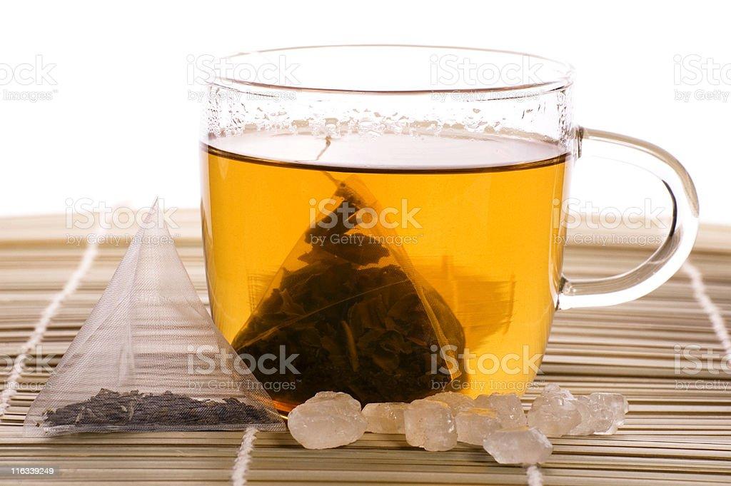 white tea, nylon tea-bag and sugar royalty-free stock photo