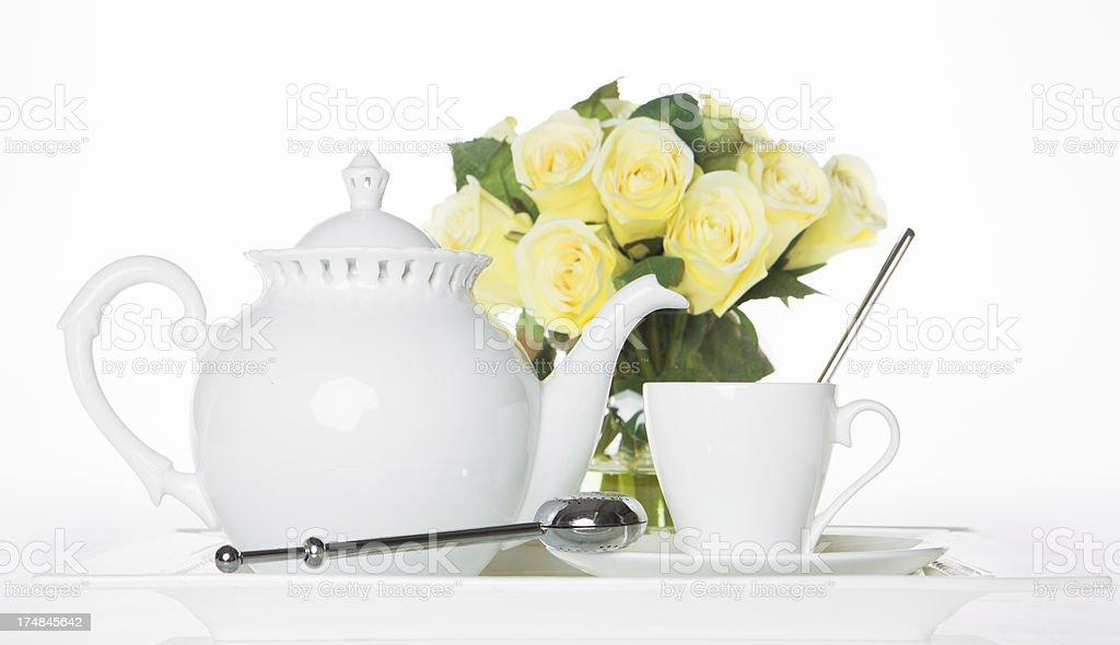 White Tea Set with yellow roses stock photo