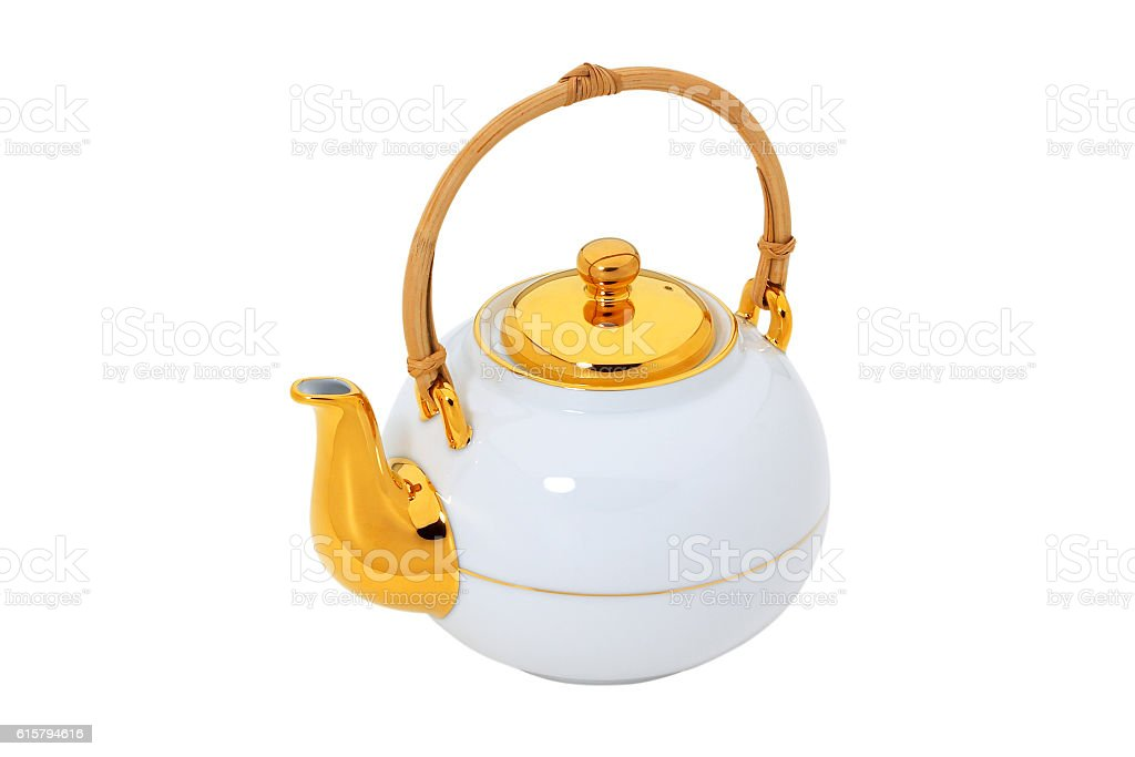 White teapot with gold and wooden handle  isolated with clipping stock photo