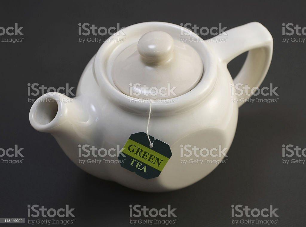 white teapot with teabag royalty-free stock photo