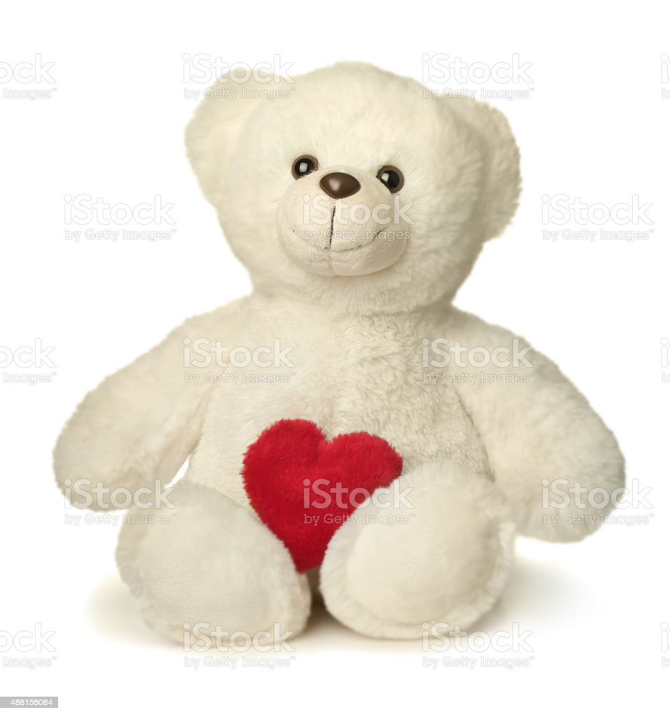 White Teddy bear with red heart isolated close up stock photo