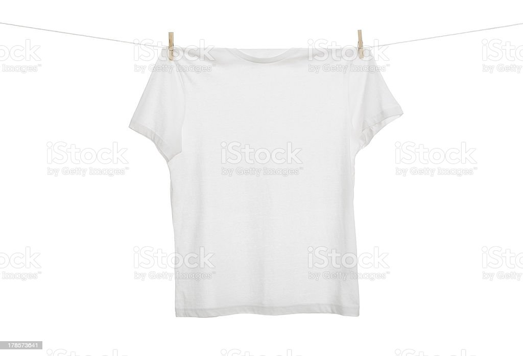 White tee shirt hanging on clothesline with clothes pins stock photo