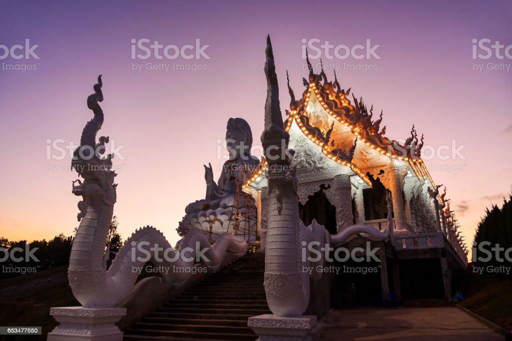 White temple with twilight sky at dusk in Wat Huay Pla Kang, Chiang Rai stock photo