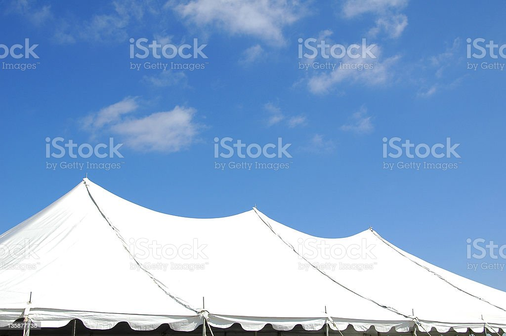White tent against the clear blue sky stock photo
