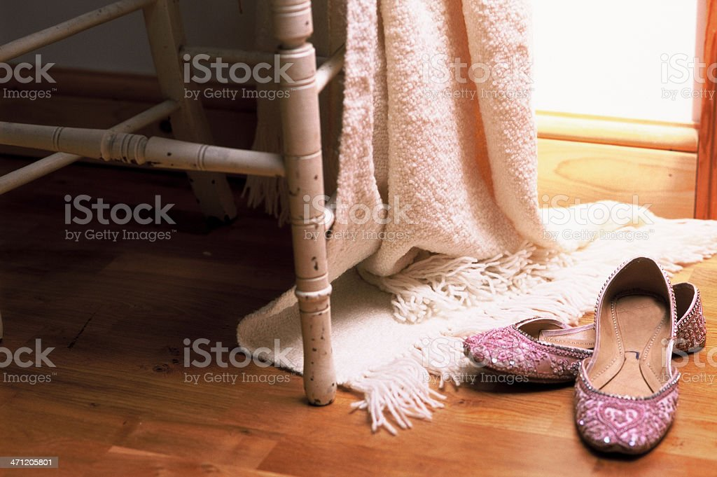 White throw and party slippers royalty-free stock photo
