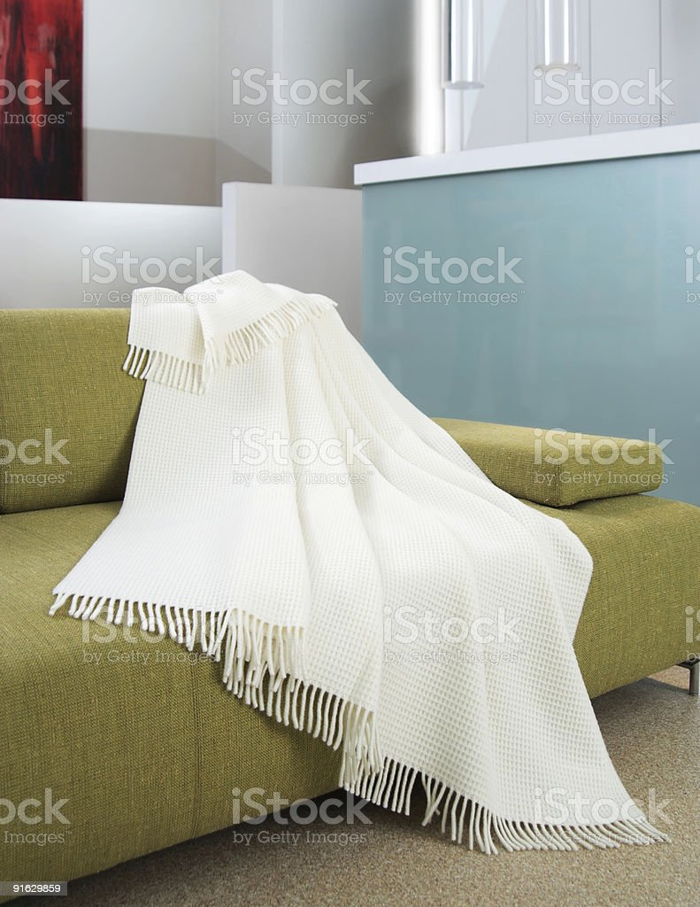 White throw draped over a settee stock photo