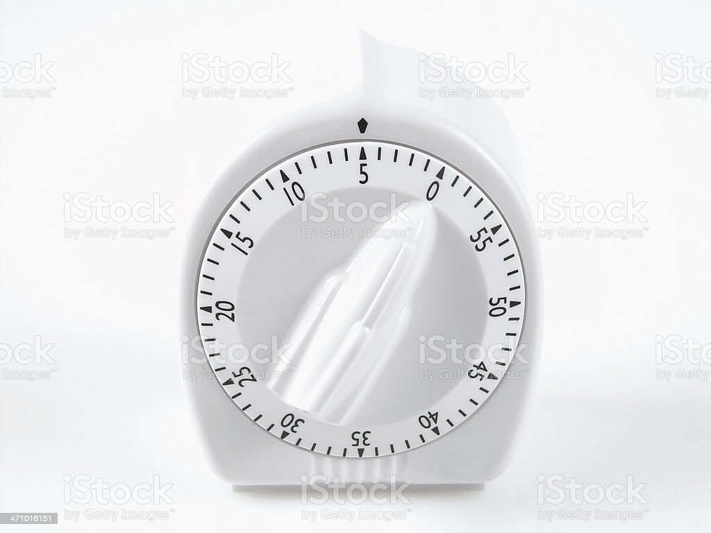 white timer set at five minutes stock photo