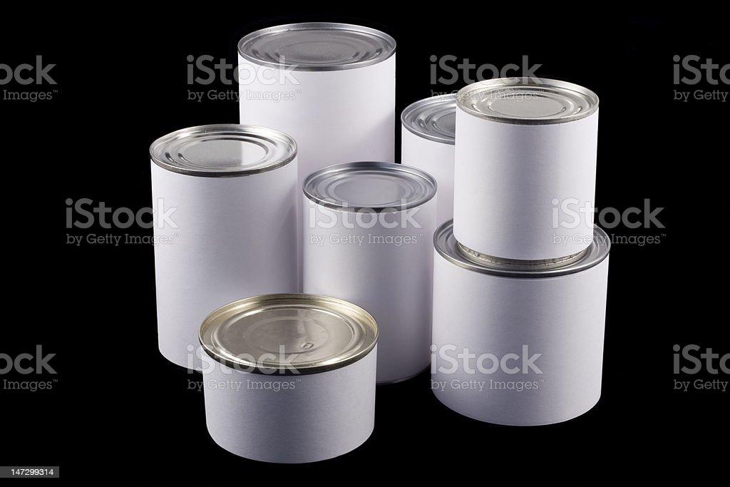White tin cans on black background royalty-free stock photo
