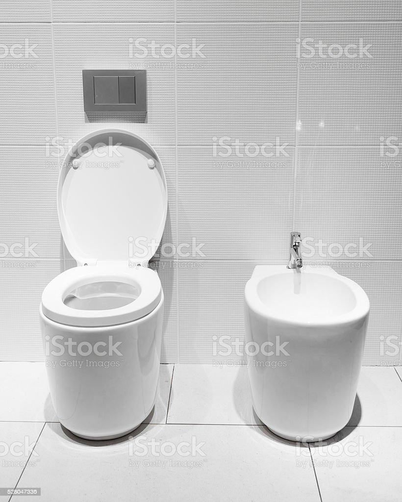 White toilet bowl in a bathroom stock photo
