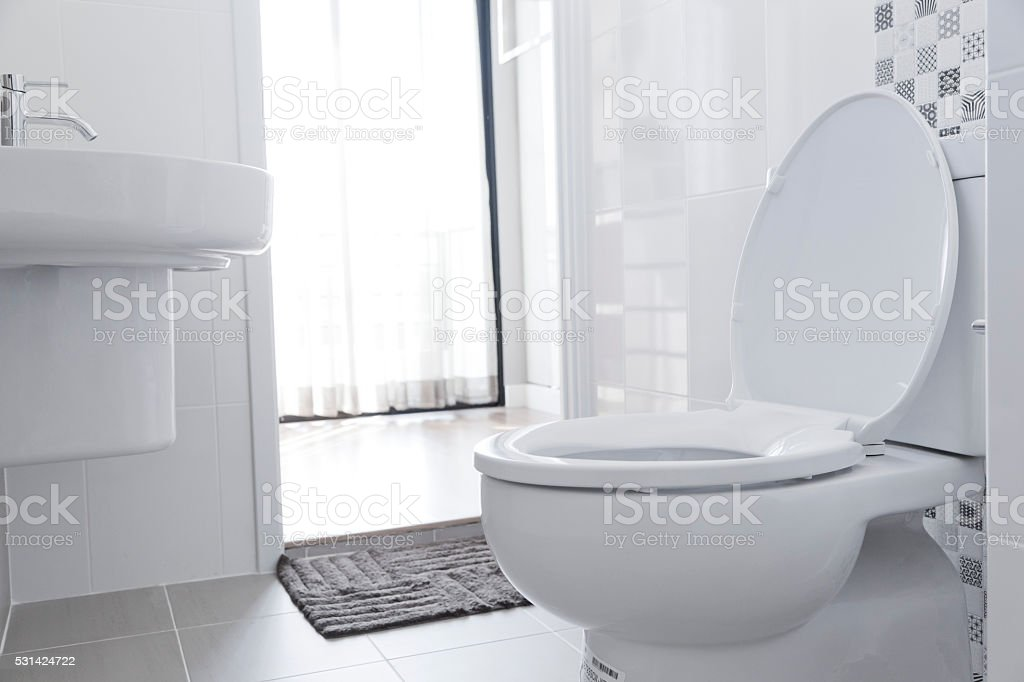 White toilet in home stock photo